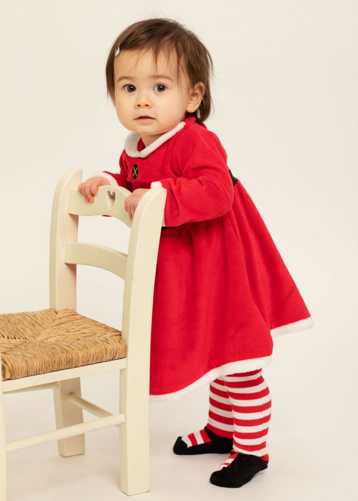 Thoughtful Christmas Gift studio portrait baby girl  in red dress www.1portrait.ie