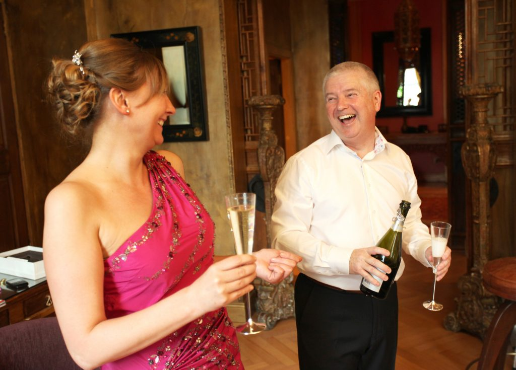 Bride and groom with champagne Civil Ceremony Wedding Photographer dublin www.1portrait.ie