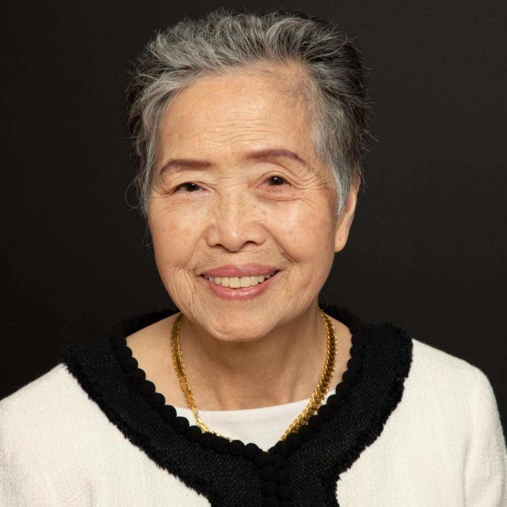Professional Portrait of Grandmother in Photography Studio with black background