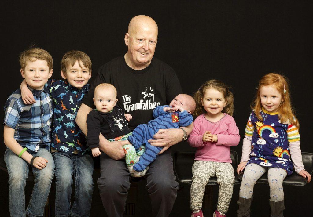 Colour family portrait studio photo of Granddad with his grandchildren Gift idea for grandparents