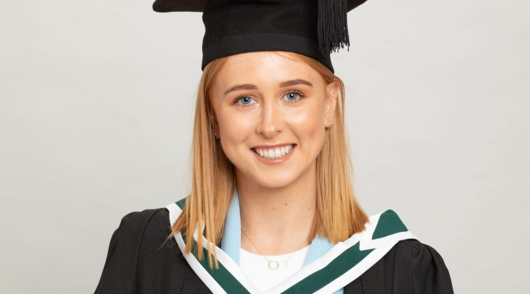 Graduation Photo for a Virtual Ceremony young female graduate in graduation robes in professional photography studio white background TU Dublin Tuesday 24th November 2020
